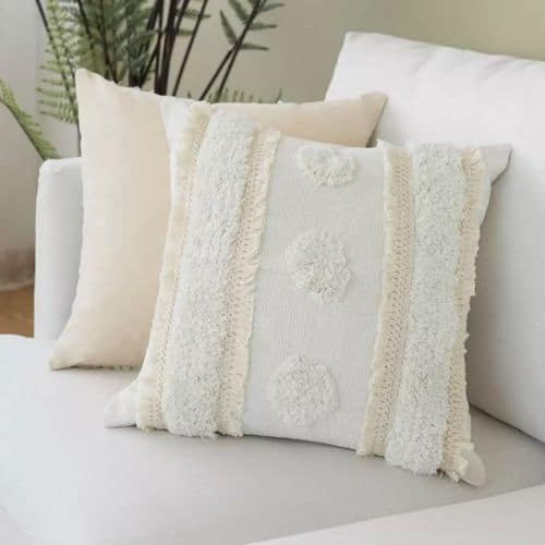 two boho cushions on the couch
