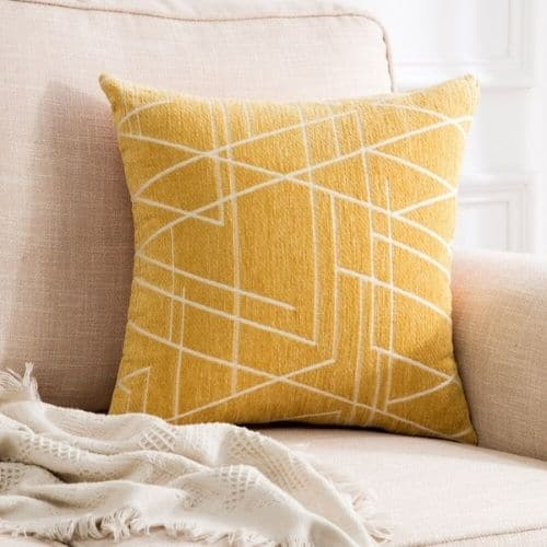 one yellow modern cushion cover on the couch