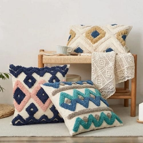 three moroccan cushion covers with white background