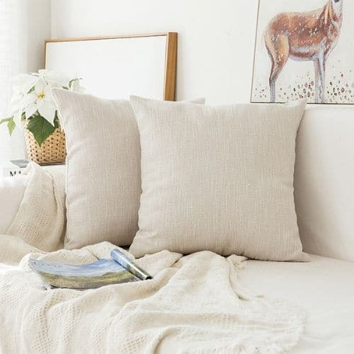 two plain cushion covers on the white couch
