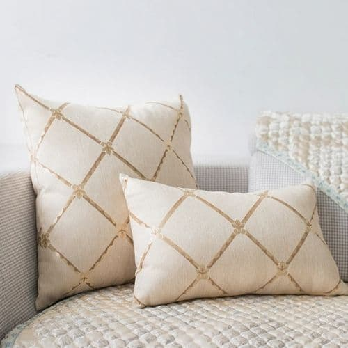 two traditional cushion covers on the sofa