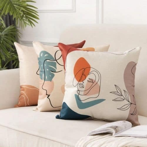 three unusual and quirky cushion covers on the couch