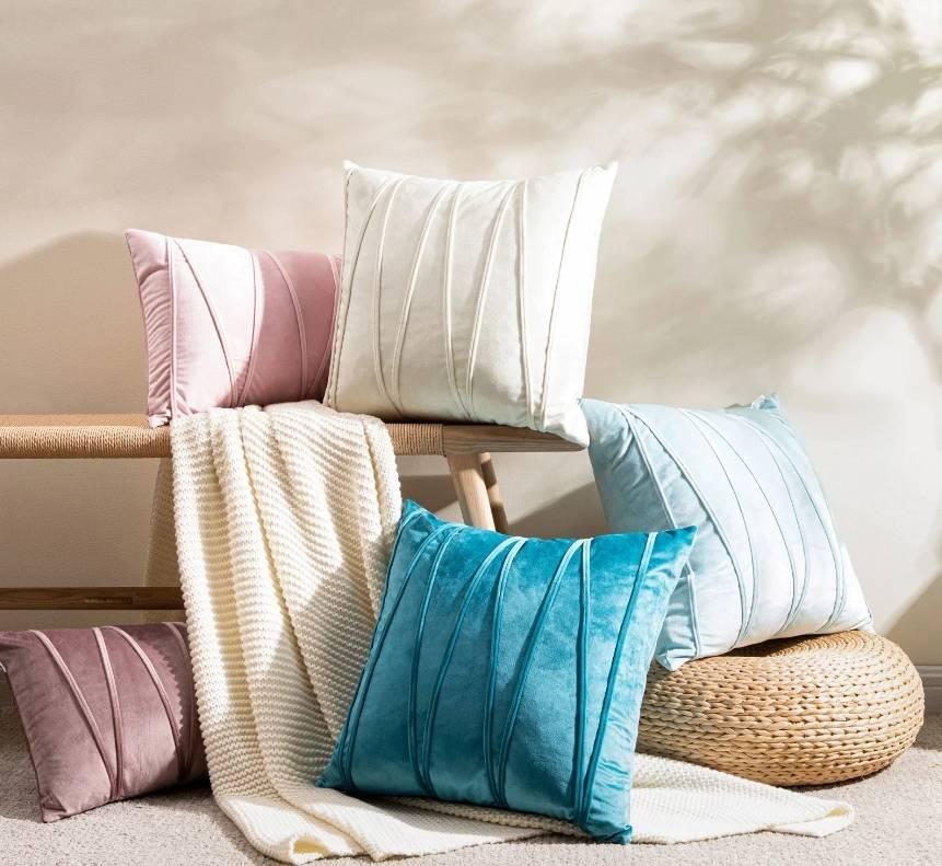 five velvet cushion covers on the floor