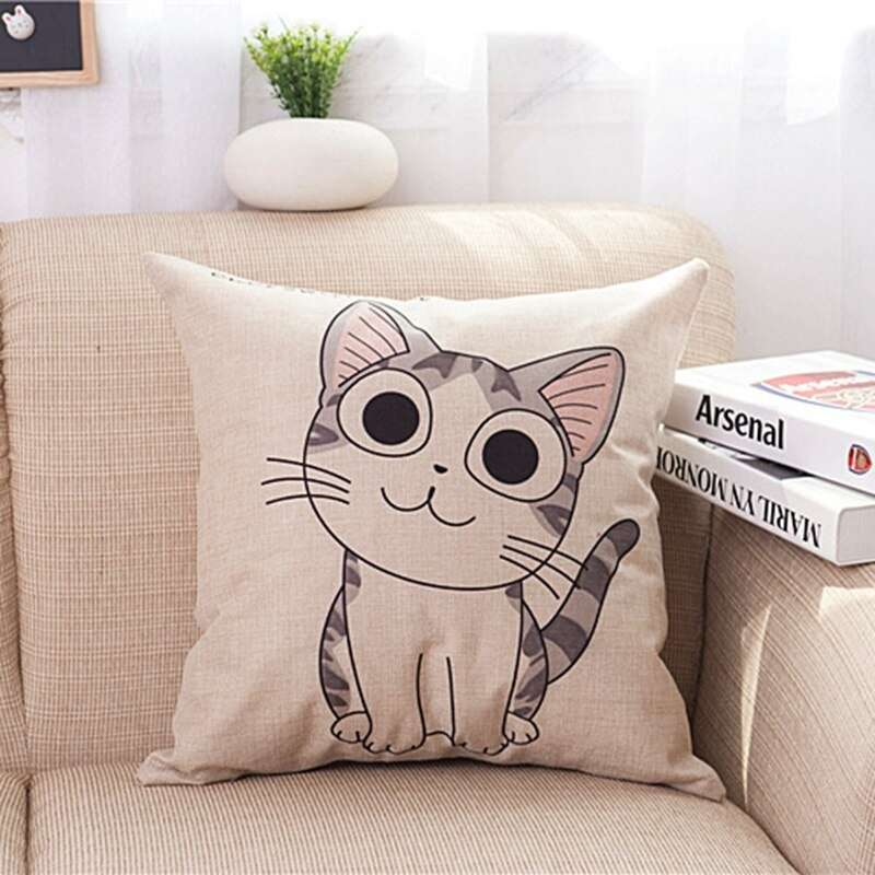 one cat cushion cover on a white sofa