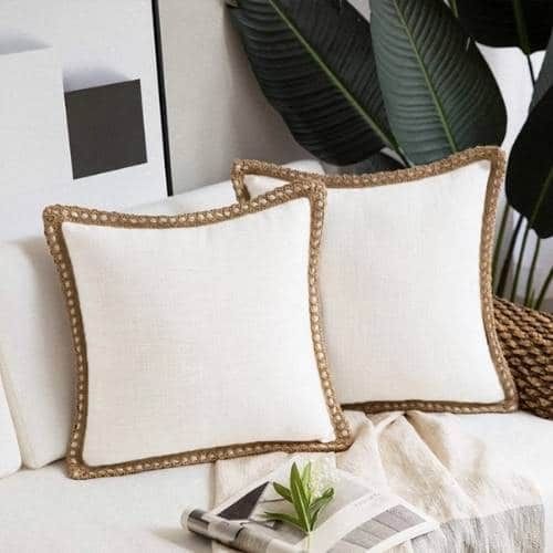 two white cotton cushion covers