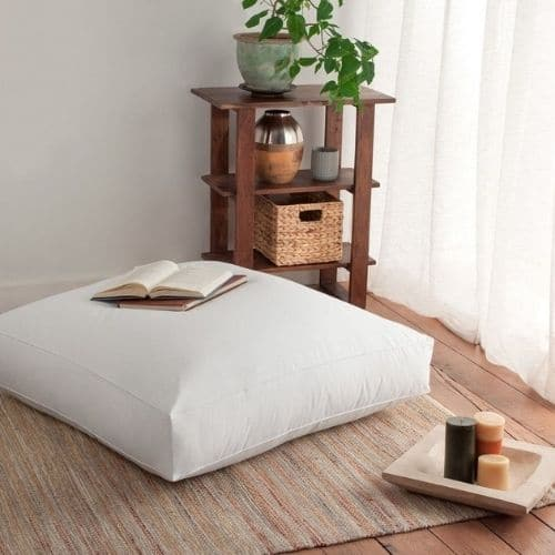one white floor cushion covers