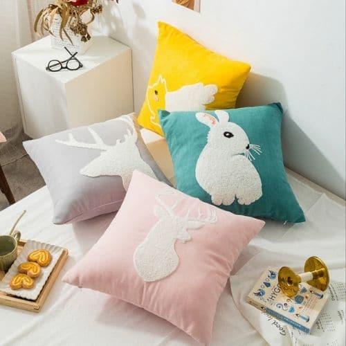 four animal cushion covers