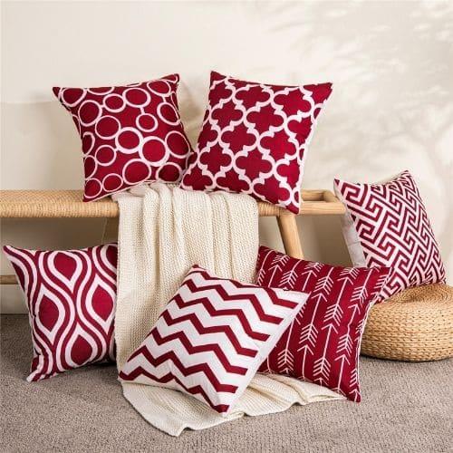 six red geometric cushion covers