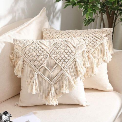two white macrame cushion covers
