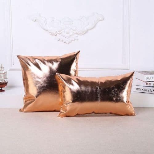 two metallic cushion covers