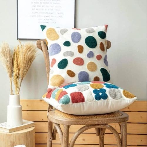 two coloured patterned cushion covers