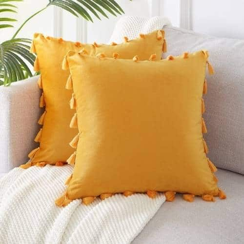 two yellow silk cushion covers