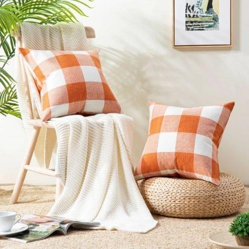 two orange tartan cushion covers