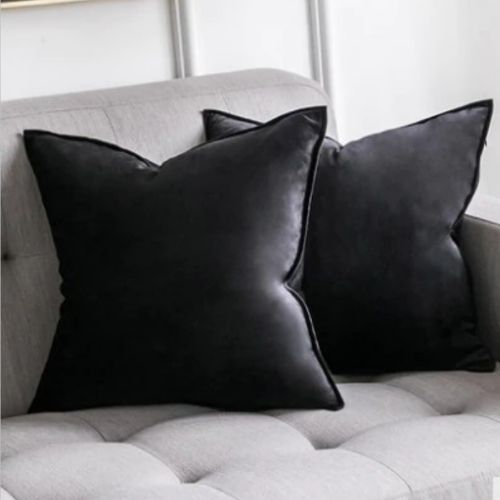 two black cushion covers