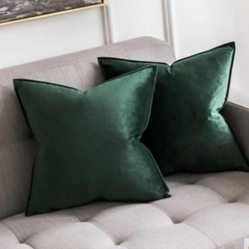 two green cushion covers