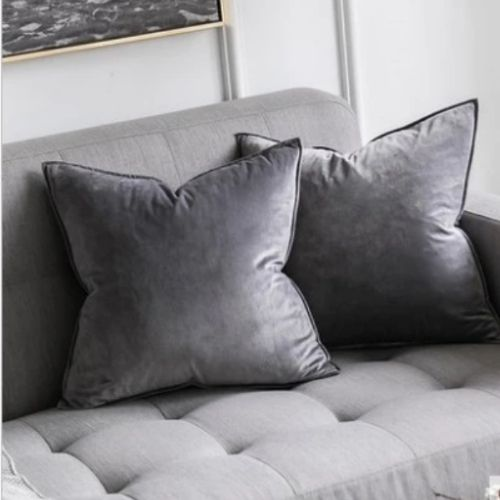 two grey cushion covers