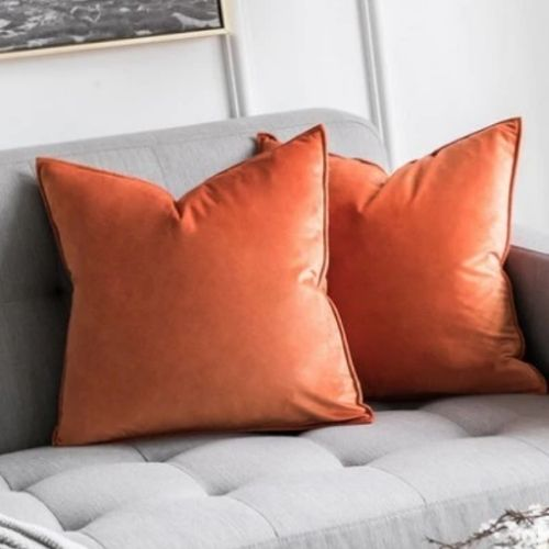 two orange cushion covers