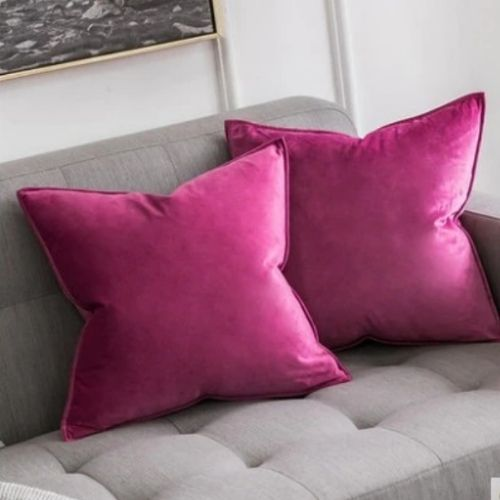 two pink cushion covers