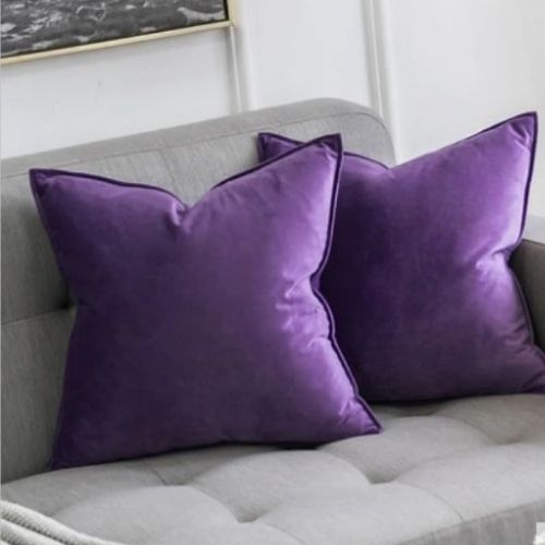 two purple cushion covers