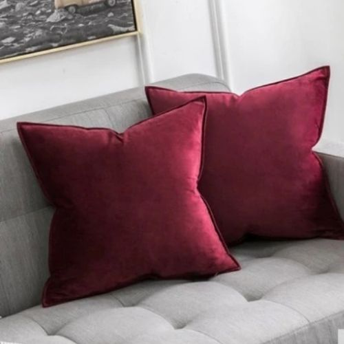 two red cushion covers