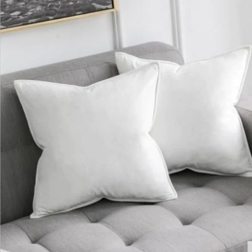 two white cushion covers