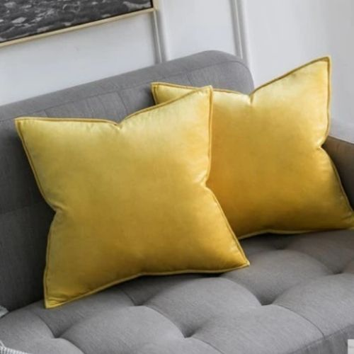 two yellow cushion covers